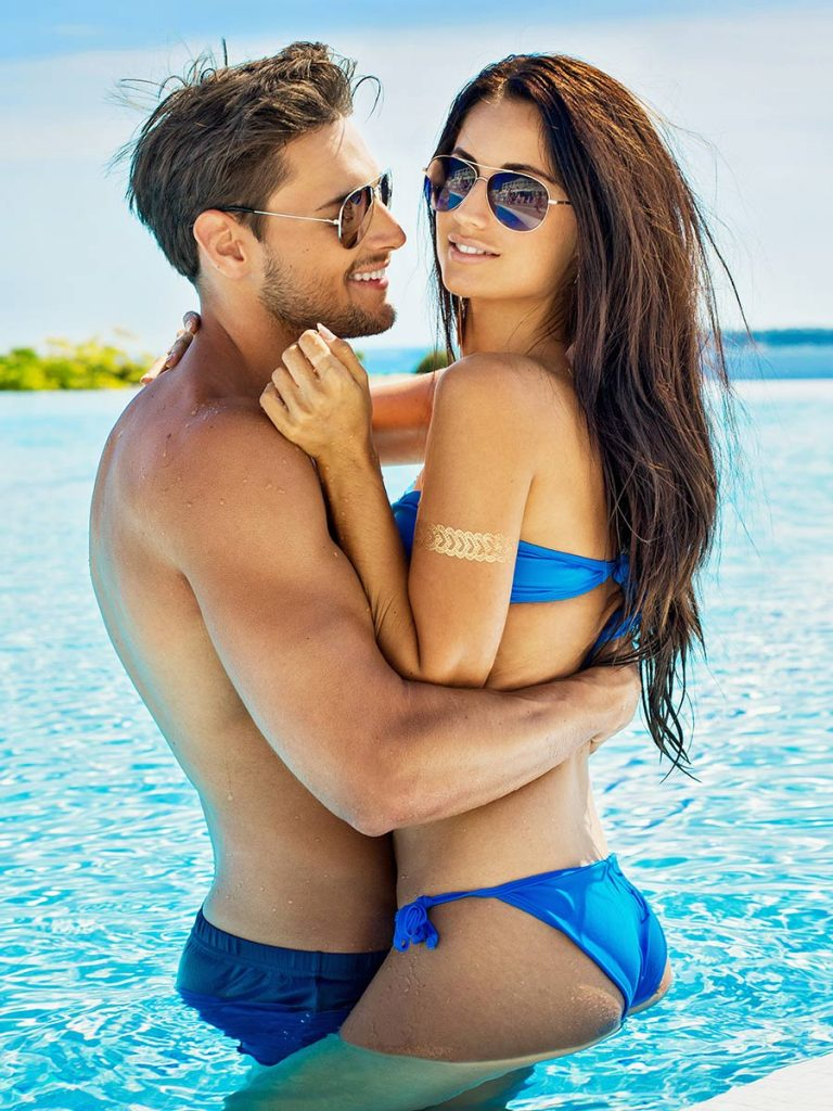 Couple at the beach pool