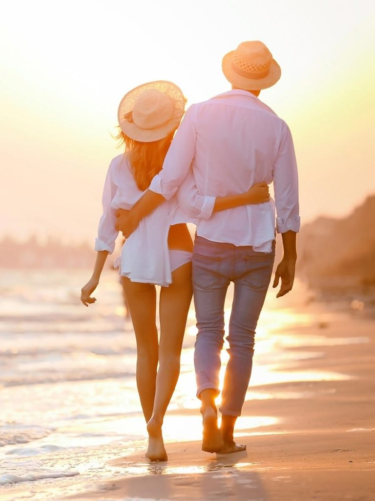 Couple takes a walk on the beach