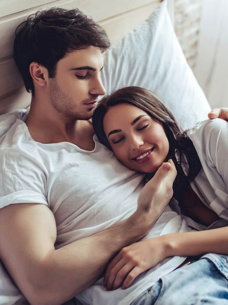 Couple chills in bed after an affair